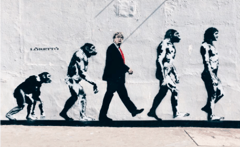 L'artista britannico Loretto ha realizzato un graffito sui muri del centro di Londra per rappresentare il presidente degli Stati Uniti come colui che interrompe la naturale evoluzione della natura dell'uomo