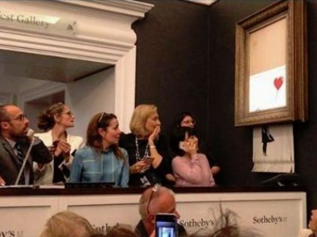 Incredibile: Quadro prezioso si autodistrugge all'asta, è l'impulso creativo di Banksy