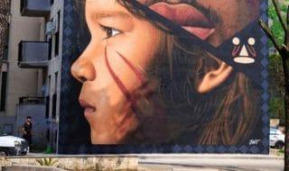 murale migrante pagella