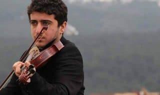 musicista curdo annegato violino